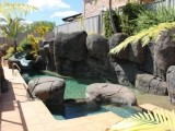 Swimming pool with boulder design
