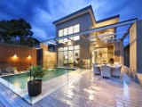 Swimming pool with glass fence